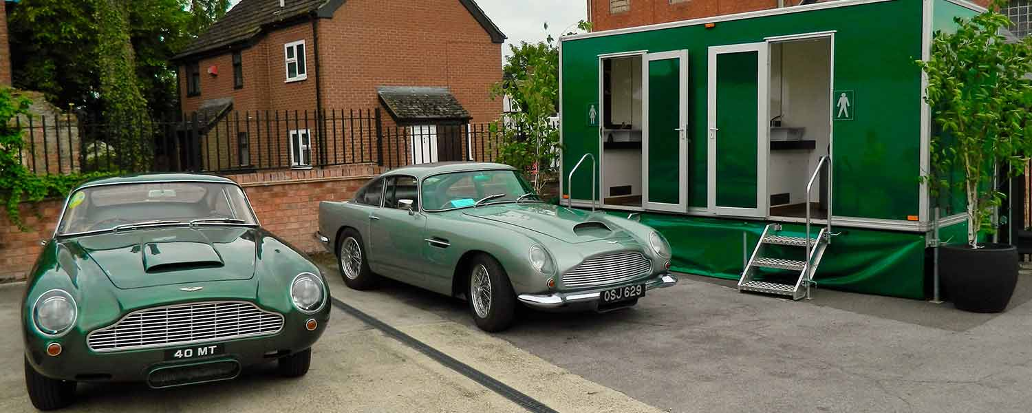 Any occasion luxury mobile toilet trailer with Aston Martin cars outside
