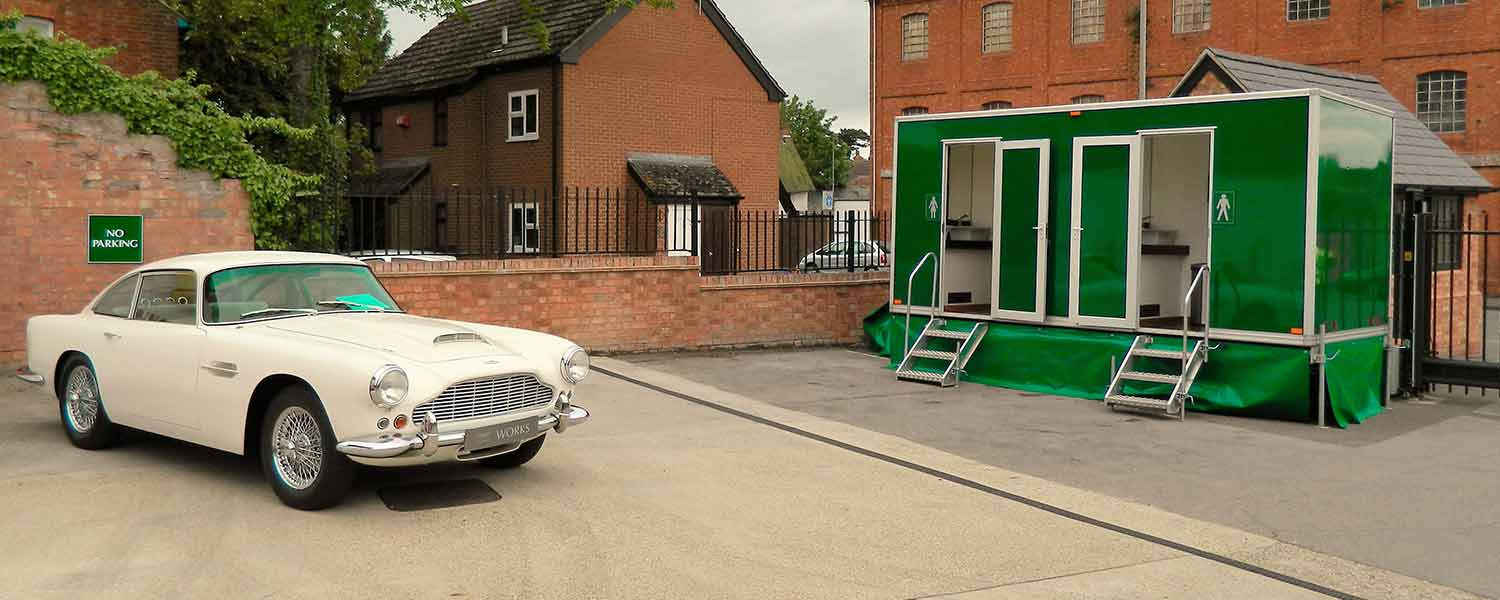 Any occasion luxury toilet trailer with white Aston Martin outside